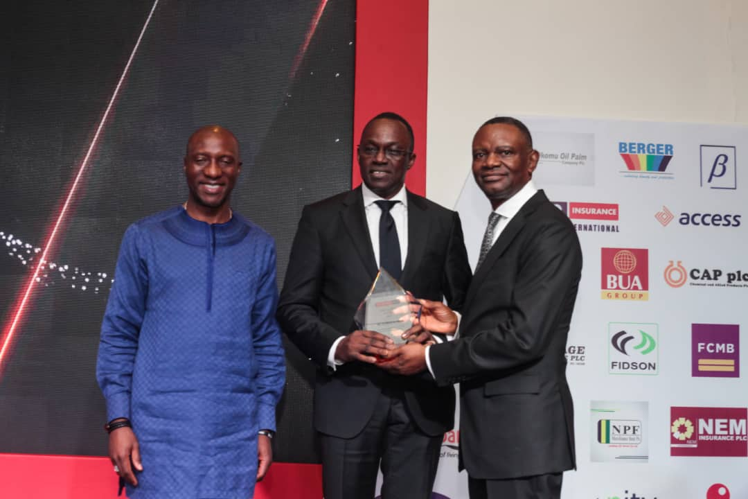 L-R Oscar Onyema, DG Nigeria Stock Exchange; Wole Oshin, MD Custodian Investment Plc receiving the Top 25 CEO Award presented by Frank Aigbogun, MD/CEO BusinessDay